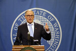Washington Gov. Jay Inslee talks to the media after a state Supreme Court ruling that reinstated a severely limited version of his plan to cap carbon pollution in the state, Thursday, Jan. 16, 2020, in Olympia, Wash. He said the ruling just strengthens his commitment to get climate change-related bills through the Legislature this year. (AP Photo/Rachel La Corte)