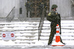 Vermont State Police troopers guard the Statehouse in Montpelier, Vt., on Wednesday, Jan. 20, 2021. Gov. Phil Scott said Tuesday he was unaware of any specific threat to the Statehouse. (AP Photo/Wilson Ring)