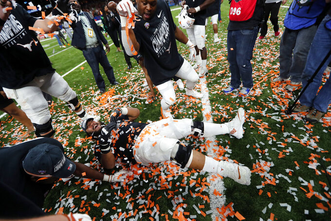 Texas players celebrate after defeating Georgia 28-21 in the Sugar Bowl NCAA college football game in New Orleans, Tuesday, Jan. 1, 2019. (AP Photo/Gerald Herbert)