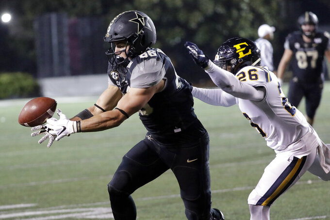 Vanderbilt tight end Ben Bresnahan (86) reaches for a pass as he is defended by ETSU defensive back Artevius Smith (26) in the second half of an NCAA college football game Saturday, Nov. 23, 2019, in Nashville, Tenn. Vanderbilt won 38-0. (AP Photo/Mark Humphrey)