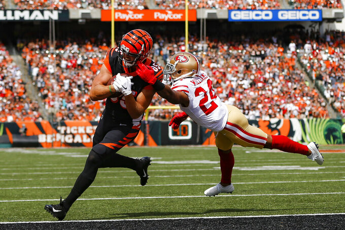 Cincinnati Bengals tight end Tyler Eifert (85) scores a touchdown against San Francisco 49ers defensive back K'Waun Williams (24) during the first half an NFL football game, Sunday, Sept. 15, 2019, in Cincinnati. (AP Photo/Frank Victores)