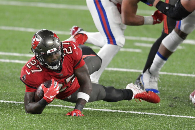 Tampa Bay Buccaneers' Ronald Jones runs the ball during the first half of an NFL football game against the New York Giants, Monday, Nov. 2, 2020, in East Rutherford, N.J. (AP Photo/Bill Kostroun)