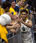 Marquette guard Markus Howard celebrate with fans after defeating Villanova during an NCAA college basketball game Saturday, Feb. 9, 2019, in Milwaukee. Marquette defeated Villanova 66-65. (AP Photo/Darren Hauck)