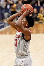 North Carolina State's C.J. Bryce hits for three against Pittsburgh during the second half of an NCAA college basketball game, Saturday, Feb. 9, 2019, in Pittsburgh. (AP Photo/Keith Srakocic)