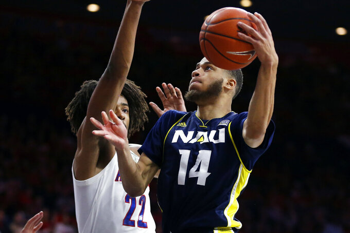 Northern Arizona guard Isaiah Lewis (14) shoots next to Arizona forward Zeke Nnaji during the first half during an NCAA college basketball game Wednesday, Nov. 6, 2019, in Tucson, Ariz. (AP Photo/Rick Scuteri)
