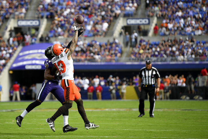 Baltimore Ravens cornerback Marlon Humphrey (44) breaks up a pass intended for Cleveland Browns wide receiver Odell Beckham (13) during the first half of an NFL football game Sunday, Sept. 29, 2019, in Baltimore. (AP Photo/Nick Wass)