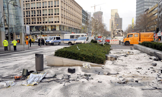 FILE - In this Feb. 1, 2016 file photo destroyed cars are seen after a crash during an illegal car race in Berlin. A German court has reinstated the murder conviction of two men whose midnight drag race in downtown Berlin ended in the death of another driver. Hamdi H. and Marvin N. in 2016, then 26 and 24, raced at 170 kph (106 mph) on Berlin's Kurfuerstendamm boulevard until Hamid H. ran into a Jeep, killing the 69-year-old driver. (Britta Pedersen/dpa via AP)