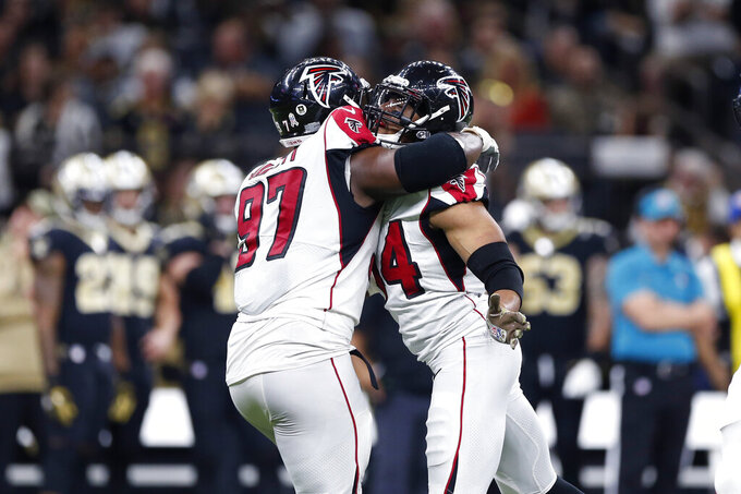 Atlanta Falcons defensive end Vic Beasley (44) celebrates his sack with defensive tackle Grady Jarrett (97) in the second half of an NFL football game against the New Orleans Saints in New Orleans, Sunday, Nov. 10, 2019. (AP Photo/Rusty Costanza)