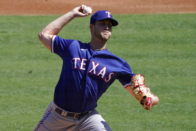 Texas Rangers starting pitcher Kyle Cody throws to a Los Angeles Angels batter during the first inning of a baseball game in Anaheim, Calif., Sunday, Sept. 20, 2020. (AP Photo/Alex Gallardo)