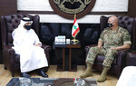 In this photo released by the Lebanese Army official website, Lebanese Army Commander Gen. Joseph Aoun, right, meets with Qatar's Deputy Prime Minister and Foreign Minister Sheikh Mohammed bin Abdulrahman bin Jassim Al-Thani, at the defense ministry, in Beirut, Lebanon, Tuesday, July 6, 2021. Qatar's Foreign Minster is in Beirut for one day visit to meet with Lebanese officials. (Lebanese Army Website via AP)