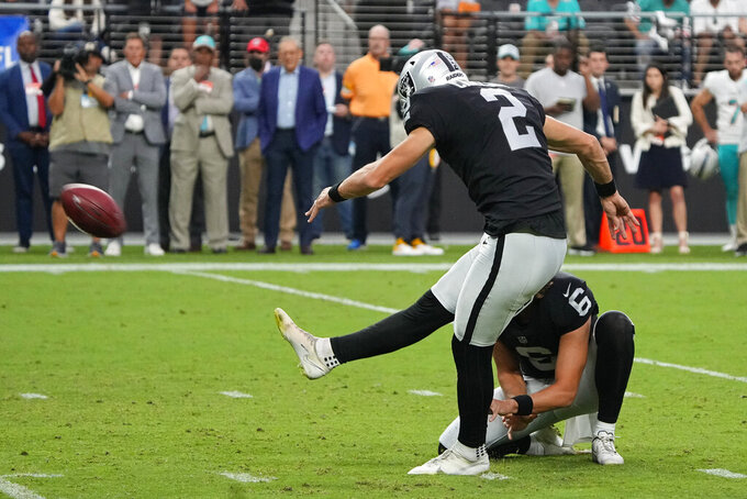 Las Vegas Raiders kicker Daniel Carlson (2) kicks a field goal against the Miami Dolphins with seconds left during overtime of an NFL football game, Sunday, Sept. 26, 2021, in Las Vegas. (AP Photo/Rick Scuteri)
