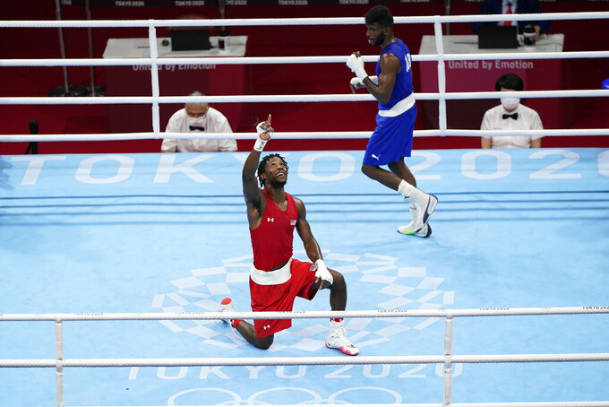 Keyshawn Davis, from the United States, left, and Cuba's Andy Cruz after their men's lightweight 63-kg boxing gold medal match at the 2020 Summer Olympics, Sunday, Aug. 8, 2021, in Tokyo, Japan. (AP Photo/Frank Franklin II)