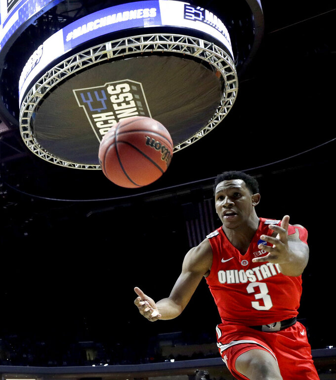 Ohio State's C.J. Jackson chases a loose ball during the second half of a first round men's college basketball game against Iowa State in the NCAA Tournament Friday, March 22, 2019, in Tulsa, Okla. Ohio State won 62-59. (AP Photo/Charlie Riedel)