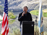Dan Mosely, executive director of Pyramid Lake Fisheries for the Pyramid Lake Paiute Tribe, offers a blessing on Wednesday, Sept. 11, 2019 before a ground-breaking ceremony for a $23.5 million fish passage project at the Truckee River's Derby Dam about 20 miles east of Reno, Nevada. The U.S. Bureau of Reclamation is buidling a bypass canal with fish screens to help the threatened Lahontan cutthroat trout pass upstream to their native spawning grounds cutoff since the dam was built in 1905. Before that, they would migrate from Pyramid Lake in the high desert 120 miles upstream to spawn in Lake Tahoe. (AP Photo/Scott Sonner)