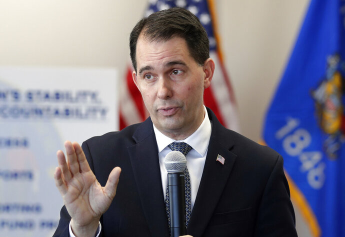 FILE - In this Dec. 14, 2018, file photo, then Wisconsin Gov. Scott Walker speaks during a news conference in Green Bay, Wis. The conservative-controlled Wisconsin Supreme Court on Friday, July 10, 2020, overturned three of four partial budget vetoes issued by Democratic Gov. Tony Evers, bucking decades of court precedent that upheld the governor's broad veto powers. However, the justices also upheld one of Evers' vetoes and declined to consider a challenge to a pair of partial vetoes issued by Republican Gov. Scott Walker in 2017, saying the 2019 lawsuit was filed too late. (Jim Matthews/The Green Bay Press-Gazette via AP File)