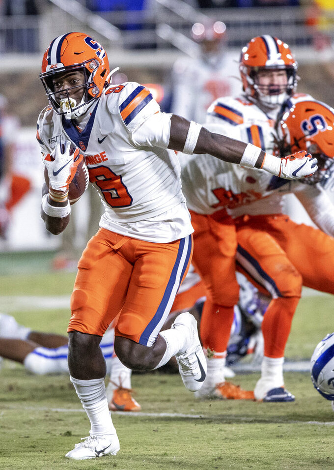 Syracuse's Evan Foster (9) carries the ball after recovering a fumble during the second half of an NCAA college football game against Duke in Durham, N.C., Saturday, Nov. 16, 2019. (AP Photo/Ben McKeown)