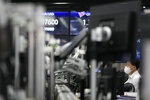A currency trader watches computer monitors at a foreign exchange dealing room in Seoul, South Korea, Friday, Sept. 17, 2021. Asian shares were mixed on Friday after a hodge-podge of economic data led Wall Street to close mostly lower. (AP Photo/Lee Jin-man)