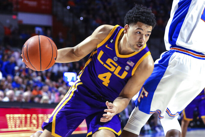 LSU guard Skylar Mays (4) drives to the basket during the first half of the team's NCAA college basketball game against Florida in Gainesville, Fla., Wednesday, March 6, 2019. (AP Photo/Gary McCullough)