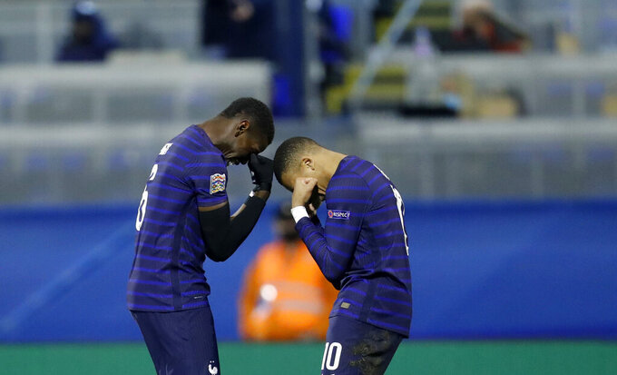 France's Kylian Mbappe, right, celebrates with France's Paul Pogba after scoring his side's second goal during the UEFA Nations League soccer match between Croatia and France at Maksimir Stadium in Zagreb, Croatia, Wednesday, Oct. 14, 2020. (AP Photo/Darko Bandic)