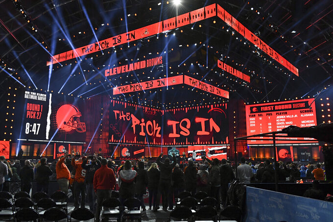 Fans gather around the stage as they wait for the Cleveland Browns to make their first-round pick in the NFL football draft Thursday April 29, 2021, in Cleveland. The Browns chose Northwestern cornerback Greg Newsome II. (AP Photo/David Dermer)
