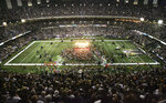 FILE - In this Sept. 25, 2006, file photo, the bands U2 and Green Day perform before the start of the Atlanta Falcons-New Orleans Saints NFL football game at the newly re-opened Louisiana Superdome in New Orleans. After a Super Bowl-like pregame show that included a performance by super groups U2 and Green Day, the Saints wasted no time turning their welcome-home party into Mardi Gras: The Falcons' first drive stalled, and special teams demon Steve Gleason sliced through the middle of the Atlanta line to smother Michael Koenen's punt. (AP Photo/Andrew Cohoon, File)