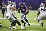 Minnesota Vikings free safety Harrison Smith (22) returns an interception during the first half of an NFL football game against the Oakland Raiders, Sunday, Sept. 22, 2019, in Minneapolis. (AP Photo/Jim Mone)