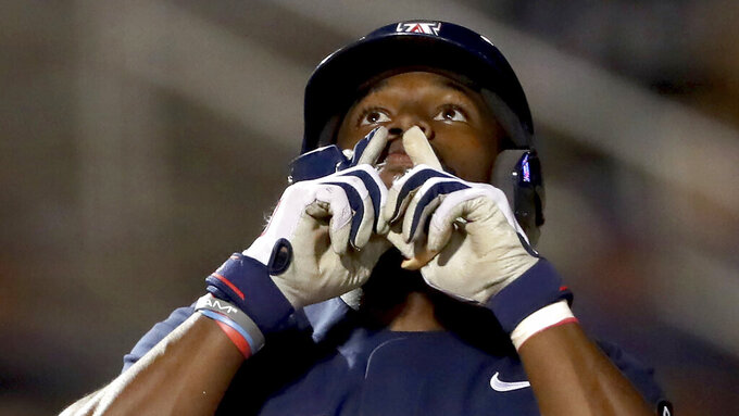 Arizona's Donta Williams (23) gestures as he crosses the plate on his solo shot to right field against Ole Miss during the seventh inning giving the Wildcats their final run of a 12-3 loss in game two of the NCAA Super Regionals at Hi Corbett Field, Tucson, Ariz., Saturday, June 12, 2021. (Kelly Presnell/Arizona Daily Star via AP)
