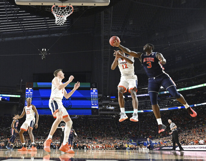 Virginia's De'Andre Hunter (12) and Auburn's Danjel Purifoy (3) battle for a rebound during the second half in the semifinals of the Final Four NCAA college basketball tournament between Auburn and Virginia, Saturday, April 6, 2019, in Minneapolis. (Brett Wilhelm/NCAA Photos via Getty Images via AP, Pool)