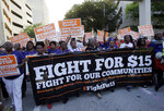 FILE - In this April 15, 2015, file photo, protesters march in support of raising the minimum wage to $15 an hour as part of an expanding national movement known as Fight for 15, in Miami. A national coalition of labor unions, along with racial and social justice organizations, will stage a mass walkout from work July 20, 2020, as part of an ongoing reckoning on systemic racism and police brutality in the U.S. (AP Photo/Lynne Sladky, File)