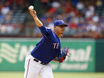 Texas Rangers starting pitcher Ariel Jurado throws against the Houston Astros in the first inning of a baseball game Sunday, July 14, 2019, in Arlington, Texas. (AP Photo/David Kent)