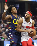 Detroit Pistons' Bruce Brown, right, drives against Cleveland Cavaliers' Collin Sexton in the second half of an NBA basketball game, Tuesday, Jan. 7, 2020, in Cleveland. Detroit won 115-113.(AP Photo/Tony Dejak)