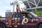 "Rodney Johnson of Chesapeake, Va., sits in his truck outside FedEx Field in Landover, Md., Monday, July 13, 2020. The Washington NFL franchise announced Monday that it will drop the ""Redskins"" name and Indian head logo immediately, bowing to decades of criticism that they are offensive to Native Americans. (AP Photo/Susan Walsh)"