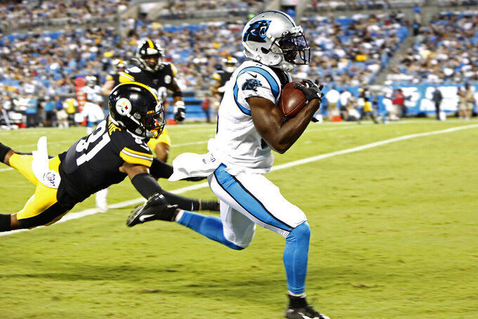 Carolina Panthers wide receiver Aldrick Robinson (8) runs for a touchdown while Pittsburgh Steelers cornerback Justin Layne (31) tries to tackle during the first half of an NFL preseason football game in Charlotte, N.C., Thursday, Aug. 29, 2019. (AP Photo/Brian Blanco)