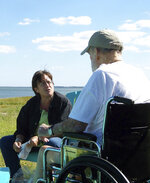 In this Sept. 29, 2009 photo provided by Betsy McNair, Betsy, left, speaks to her father Robert McNair at Bulls Landing on Mockhorn Bay outside of Townsend, on the Eastern Shore of Virginia. Robert McNair was 83 when he died at his home in Belle Haven, Virginia, in 2009, six weeks after learning he had lung cancer.  Betsy, who helped care for him before his death, is proud of the ending she helped give her father. For the first time since the early 1900s, more Americans are dying at home rather than in hospitals, a trend that reflects more hospice care and progress toward the kind of end that most people say they want. (Paul McNair/Courtesy of Betsy McNair via AP)