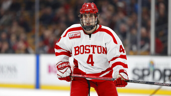 FILE - Boston University's David Farrance is shown during an NCAA college hockey game against Northeastern in Boston, in a Feb 4, 2019, file photo. On Friday night, Jan. 8, 2021, BU will become the last Division I men's team to start its season when Providence visits.  The game will be at Walter Brown Arena because the team's regular home, Agganis Arena, has been repurposed as a campus COVID-19 test site. (AP Photo/Winslow Townson, File)