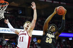 Purdue's Trevion Williams (50) pulls down his own rebound against Wisconsin's Micah Potter (11) during the first half of an NCAA college basketball game Tuesday, Feb. 18, 2020, in Madison, Wis. (AP Photo/Andy Manis)