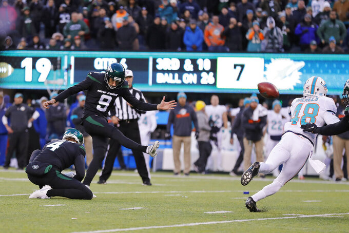 New York Jets kicker Sam Ficken (9) kicks the winning field goal during the second half of an NFL football game against the Miami Dolphins, Sunday, Dec. 8, 2019, in East Rutherford, N.J. (AP Photo/Adam Hunger)