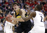 Iowa's Luka Garza (55) drives past Cincinnati's Keith Williams (2) in the second half during a first round men's college basketball game in the NCAA Tournament in Columbus, Ohio, Friday, March 22, 2019. (AP Photo/Tony Dejak)