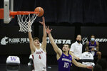 Washington State forward Aljaz Kunc (4) and Washington guard Erik Stevenson (10) go after a rebound during the second half of an NCAA college basketball game in Pullman, Wash., Monday, Feb. 15, 2021. (AP Photo/Young Kwak)