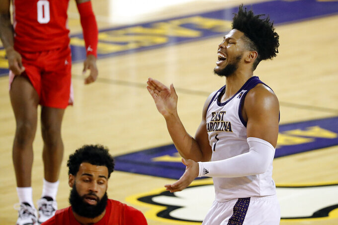 East Carolina's Jayden Gardner (1) starts to celebrate during the closing minutes of the second half of an NCAA college basketball game against Houston in Greenville, N.C., Wednesday, Feb. 3, 2021. (AP Photo/Karl B DeBlaker)