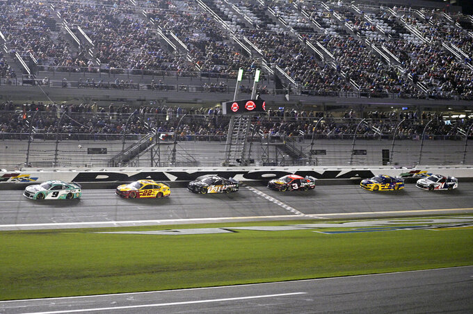 Chase Elliott (9) leads a pack of cars through the front stretch during a NASCAR Cup Series auto race at Daytona International Speedway, Saturday, Aug. 28, 2021, in Daytona Beach, Fla. (AP Photo/Phelan M. Ebenhack)