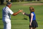 In this Aug. 28, 2019, photo, Amy Bockerstette, right, gets a high-five from her swing coach, Matt Acuff, at Palmbrook Country Club in Sun City, Ariz.