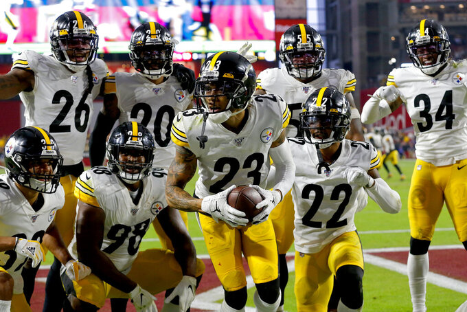Pittsburgh Steelers cornerback Joe Haden (23) celebrates his interception against the Arizona Cardinals with teammates during the second half of an NFL football game, Sunday, Dec. 8, 2019, in Glendale, Ariz. (AP Photo/Rick Scuteri)