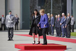 German Chancellor Angela Merkel, right, welcomes the Prime Minister of New Zealand Jacinda Ardern, left, for a meeting at the chancellery in Berlin, Germany, Tuesday, April 17, 2018. (AP Photo/Markus Schreiber)