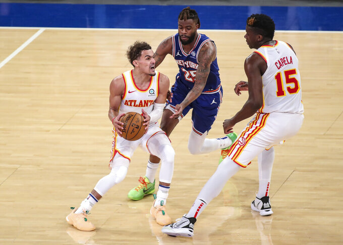 Atlanta Hawks guard Trae Young (11) looks to drive past New York Knicks forward Reggie Bullock (25) during the fourth quarter of Game 5 of an NBA basketball first-round playoff series Wednesday, June 2, 2021, in New York. (Wendell Cruz/Pool Photo via AP)