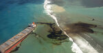 This photo provided by the French Defense Ministry shows oil leaking from the MV Wakashio, a bulk carrier ship that recently ran aground off the southeast coast of Mauritius,, Sunday Aug.9, 2020. The Indian Ocean island of Mauritius has declared a
