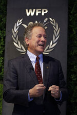 FILE - In this Dec. 6, 2018 file photo, David Beasley, the executive director of the World Food Programme, speaks to The Associated Press during an interview in Rome. In the wake of an internal survey that detailed multiple allegations of rape and sexual harassment of its female staffers, Beasley vowed to go after abusers. Beasley said over the past year he has been increasing the number of investigators at the agency to 22 to look into allegations of misconduct, including a number who specialize in dealing with victims of sexual violence. (AP Photo/Gregorio Borgia, File)