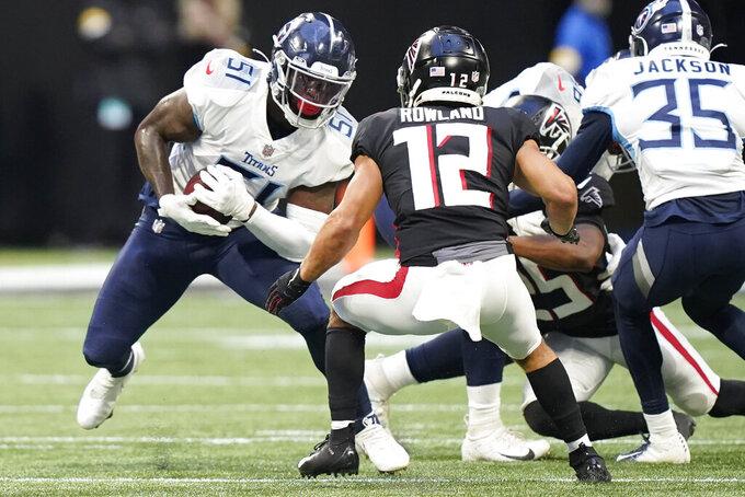 Tennessee Titans linebacker David Long (51) runs the ball after an interception against the Atlanta Falcons during the first half of a preseason NFL football game, Friday, Aug. 13, 2021, in Atlanta. (AP Photo/Brynn Anderson)