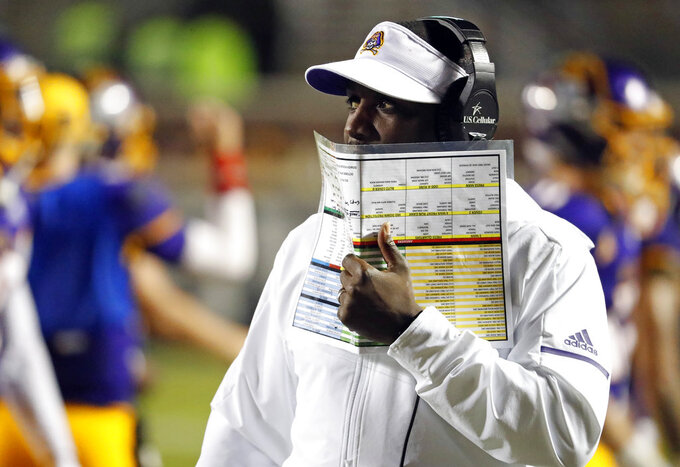 East Carolina head coach Scottie Montgomery walks the sideline during the second half of an NCAA college football game against Central Florida in Greenville, N.C., Saturday, Oct. 20, 2018. UCF won 37-10. (AP Photo/Karl B DeBlaker)