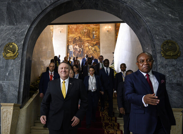 US Secretary of State Mike Pompeo, left, leaves with Angola Foreign Minister, Manuel Domingos Augusto after a press conference at the Ministry of Foreign Affairs in Luanda, Angola, Monday Feb. 17, 2020. Pompeo started his tour of Africa in Senegal, the first U.S. Cabinet official to visit in more than 18 months. He left Senegal Sunday to arrive in Angola and will then travel on to Ethiopia as the Trump administration tries to counter the growing interest of China, Russia and other global powers in Africa and its booming young population of more than 1.2 billion. (Andrew Caballero-Reynolds/Pool via AP)